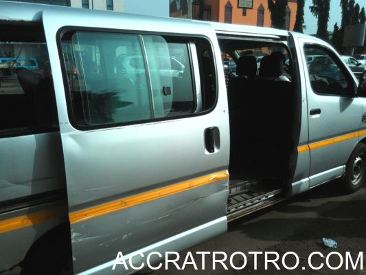 Trotro bus door opened in anticipation of passengers at Accra Central